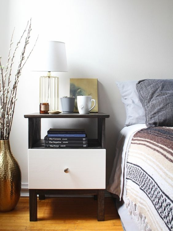 a contrasting IKEA Tarva nightstand hack - dark stained wood plus a white drawer and a metallic knob