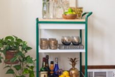 03 an IKEA Bygel cart with a wooden countertop and bright green framing plis casters is a bold idea