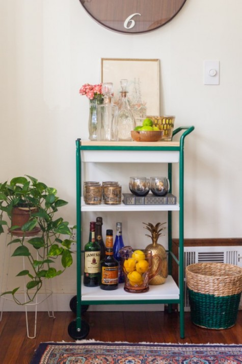 an IKEA Bygel cart with a wooden countertop and bright green framing plis casters is a bold idea