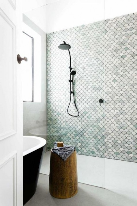 a simple shower is made cooler with aqua-colored, white and blush fishscale tiles that mismatch in color but match in shape