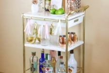04 an IKEA Bygel cart hack with gold spray paint and marble contact paper is an easy way to create a chic furniture piece