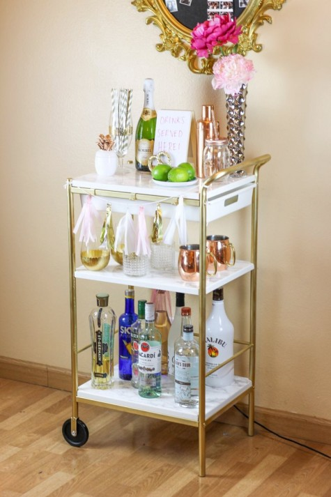 an IKEA Bygel cart hack with gold spray paint and marble contact paper is an easy way to create a chic furniture piece