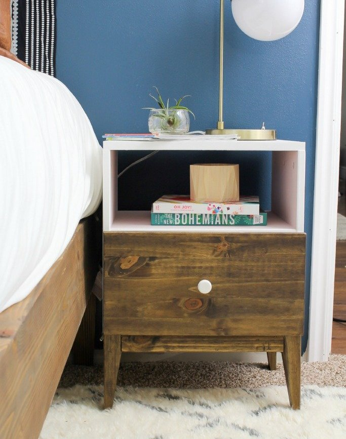 an IKEA Tarva nightstand hack with blush paint and a stained part is a cool idea for a boho space