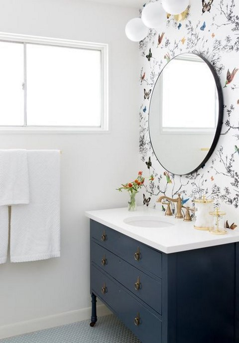 chic and bright bird and floral wallpaper statement wall is a great idea for a bathroom
