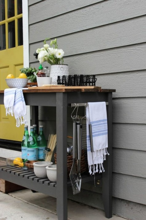 an IKEA Forhoja cart done in graphite grey and with a wooden tabletop is a stylish and practical idea