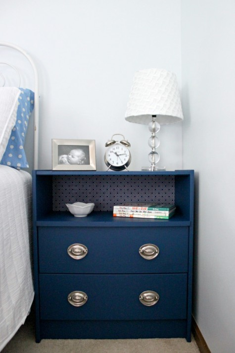 an elegant Rast dresser hack with new silver knobs and a wallpaper covered compartment as a cool nightstand