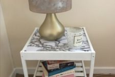 06 a Nesna table with dipped legs and a marble contact paper top as marble is a very edgy and bold material