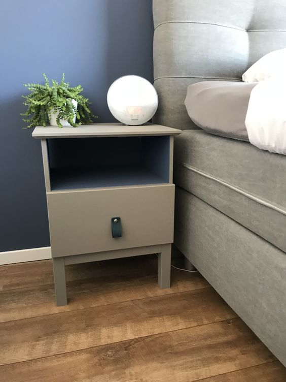 an IKEA Tarva nighstand painted grey and with a black leather pull is a simple makeover for a boho or modenr space