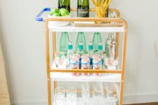 07 a chic bar cart out of a usual IKEA utility cart repainted and decorated with contact paper is a great idea