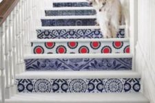 07 give your stairs a bold look decorating them with bright printed wallpaper – different for each riser