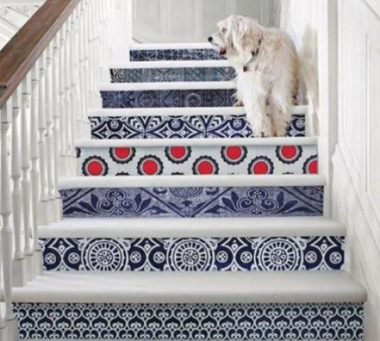 give your stairs a bold look decorating them with bright printed wallpaper – different for each riser