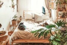 08 a small boho bedroom with a large bed, some wooden and wicker items and potted greenery