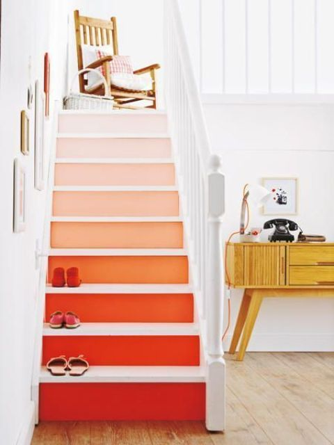 a chic ombre staircase in bright shades is a cool idea for a modern and bright space, it adds color