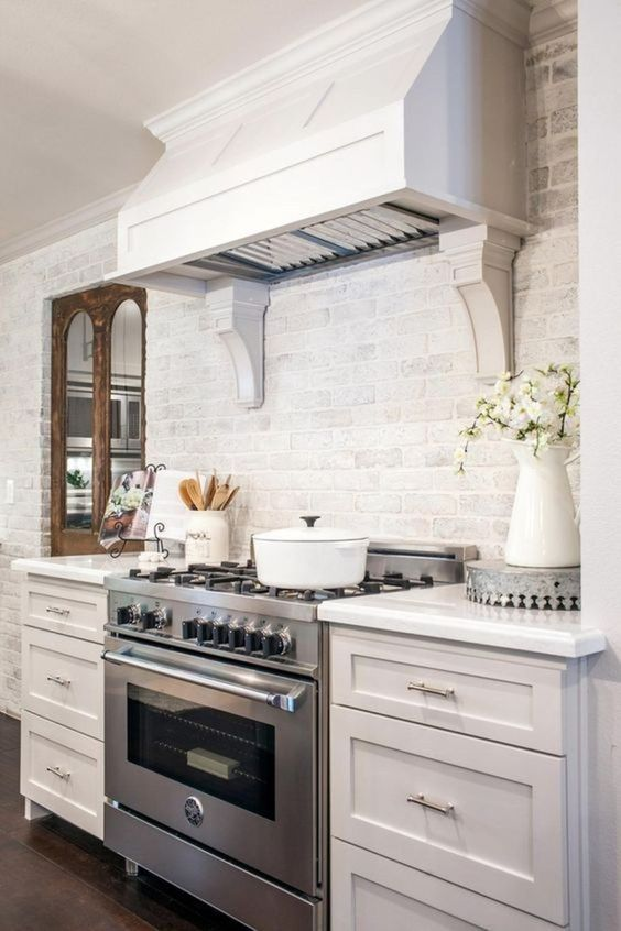 a cute farmhouse kitchen design with a brick backsplash