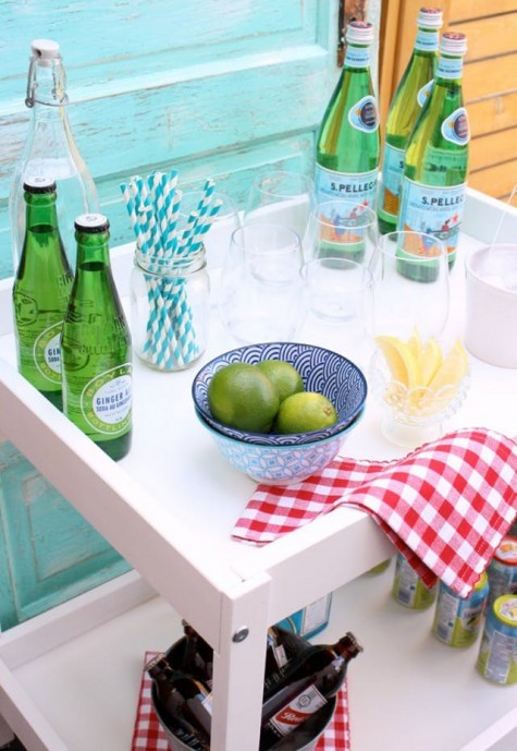 an outdoor bar cart made of an IKEA changing table placed on casters is an easy hack for indoors or outdoors
