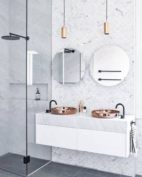 exquisite marble fishscale tiles make the sink area stand out and give a texture to the space