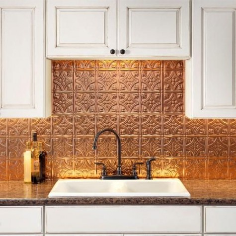 hammered copper tiles bring a cool Moroccan feel to tthe super neutral white kitchen