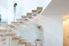 10 a floating staircase made of wood and with glass railing that holds the steps at the same time looks very modern