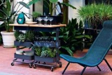 10 an outdoor bar in black with a wooden countertop using two IKEA Raskog carts for storage