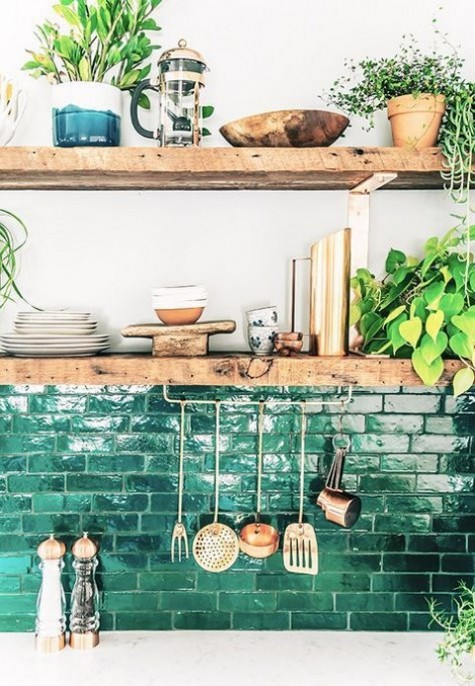 a brick backsplash painted emerald and lacquered for a cool glossy look and more functionality too