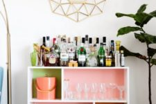 11 a bright open home bar made of an IKEA Valje shelf with colorful backing done with usual paints inside