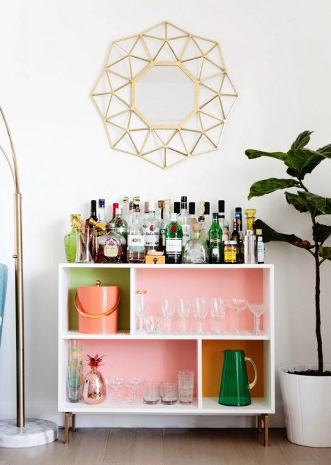 a bright open home bar made of an IKEA Valje shelf with colorful backing done with usual paints inside