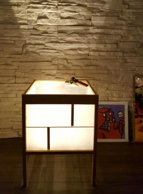an IKEA Nesna hack into a lamp table is a unique idea to light up your space and have a storage unit, too