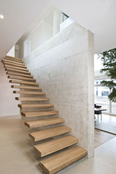 attaching the steps to the wall gives them really a floating and seamless look