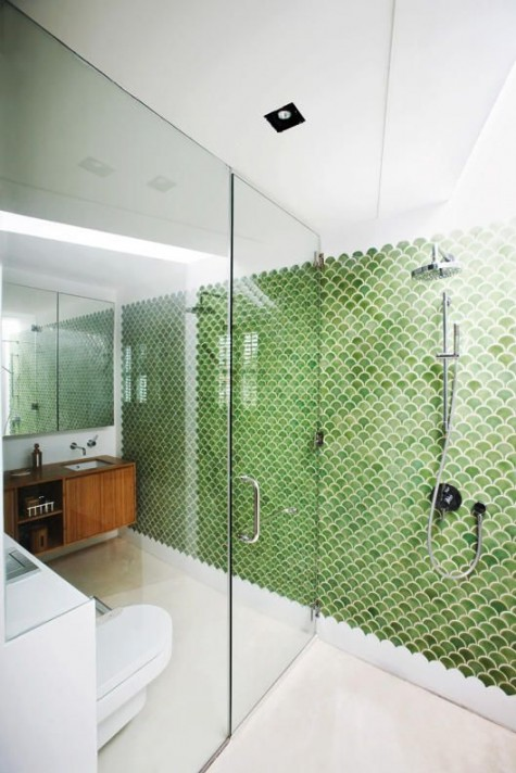 green fishscale tiles define the whole space and stand out a lot in its neutral and calming shades