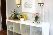12 a chic yet very simple home bar of an IKEA Kallax unit placed on legs – what can be easier