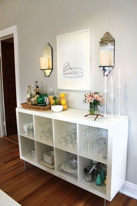 a chic yet very simple home bar of an IKEA Kallax unit placed on legs   what can be easier