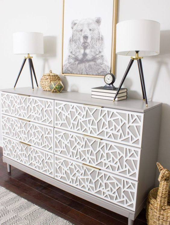 a creative Tarva dresser hack in dove grey, with white geometric inlays and tiny brass pulls instead of usual ones