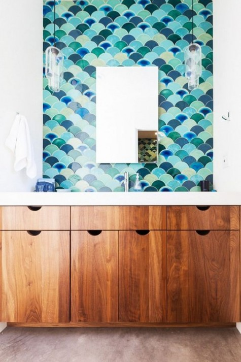sea-inspired colorful fishscale tiles make a statement in this sink space and make it stand out