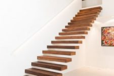 13 the secret of seamless staircases is attaching them to walls to make them look ethereal