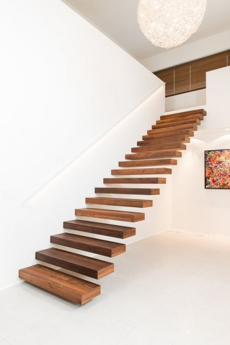 the secret of seamless staircases is attaching them to walls to make them look ethereal