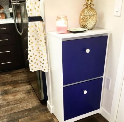 a bold IKEA Bissa hack with electric blue fronts and contrasting white knobs for a bold contemporary space