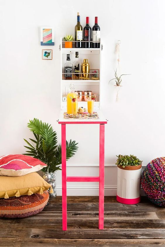 a colorful Murphy home bar made using an IKEA bathroom shelf and some bright paints and wood