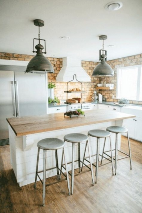 a farmhouse kitchen with a yellow brick backsplash look cool and interesting and metal touches add a retro feel