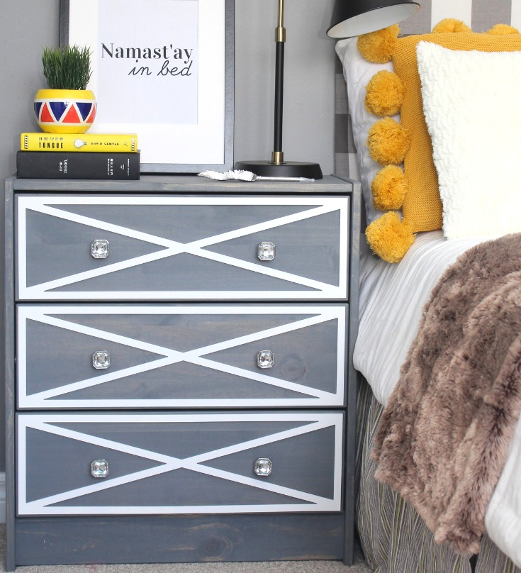 a modern nightstand of an IKEA Rast dresser in grey and white, with crystal knobs is a chic idea