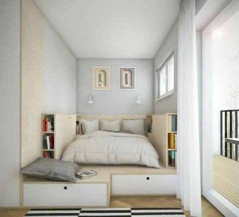 a tiny and creative bedroom with a podium with much storage space and a bed placed in it