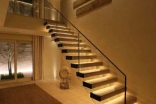 15 a floating staircase with additional lights built-in that make it stand out and look bolder and catchier