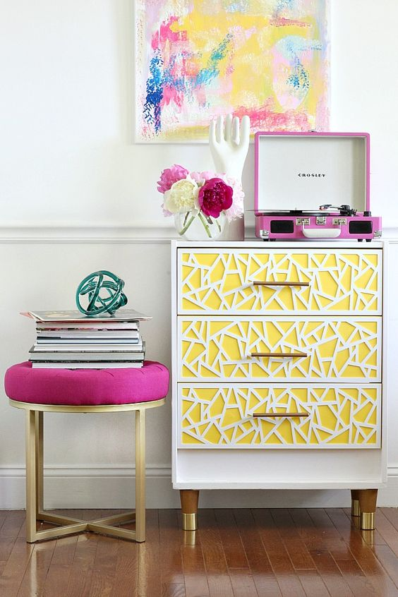 a fun and quirky IKEA Rast hack done with bright yellow and white geomeric inlays and gold legs for a glam space