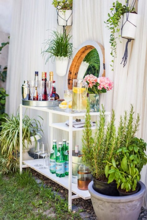 a glam outdoor bar made of an IKEA Micke desk is a genius idea that can be implemented indoors, too