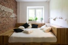 15 a small bedroom with a podium bed with much built-in storage that allows to declutter the space
