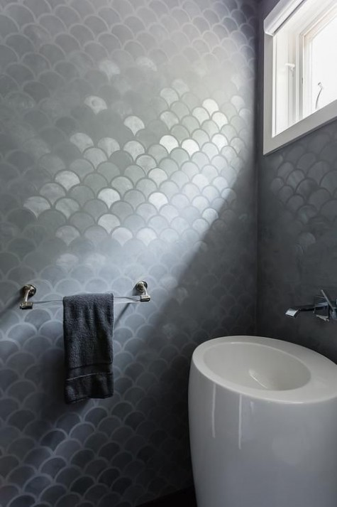 ultra-modern bathroom with gray metallic fishscale tiles and a white egg-shaped free-standing sink