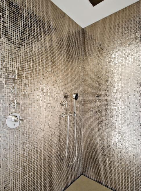 a shower space fully done with small silver mosaic tiles looks all shining and bold and stands out