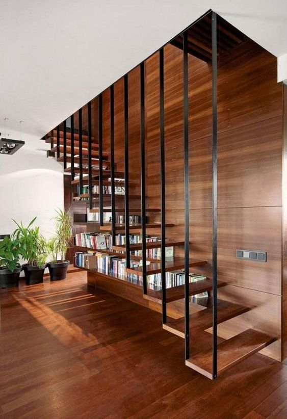 a suspended staircase with a bookcase built in is a cool idea for a contemporary living room