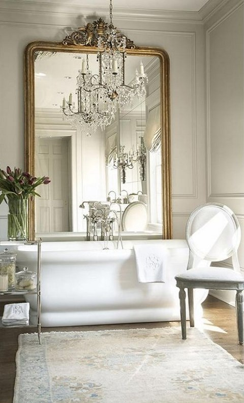 an oversized mirror in a refined French frame will make your bathroom sophisticated
