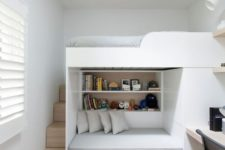 18 a small kid's space with a built-in bed and seat unit plus a desk on the side for an ultimate look