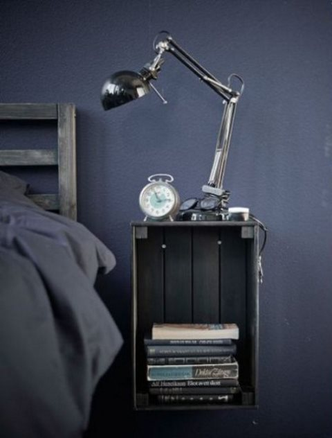 a Knagglig box painted grey and attached to the wall makes up a cool floating bedside table that you can easily DIY